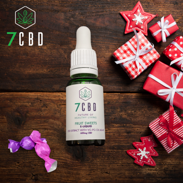 CBD E-liquid on a table with Christmas decorations