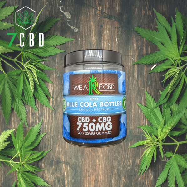 CBD Gummy tub on woodern table with hemp leaves either side